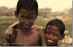 Brothers in Arm (Shabbir Ferdous) Tags: travel family portrait sky nature kids fun photographer bangladesh dinajpur bangladeshi canonef50mmf18ii canoneosrebelxti shabbirferdous shabbirspeople wwwshabbirferdouscom shabbirferdouscom