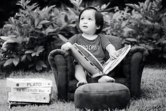 light summer reading. (*Peanut (Lauren)) Tags: bw reading blackwhite books 21months 20months chairottoman kidsreading mysonisnotagirlp