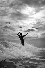 Riding High (SmithShady) Tags: ocean film beach blackwhite surf waves northcarolina surfing velvia surfboard surfers july4th fujichrome nikonos pineknollshores