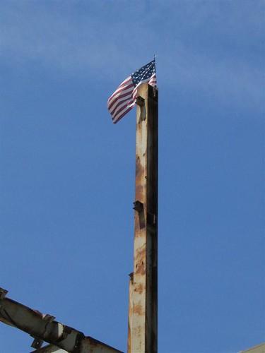 American flag rises high