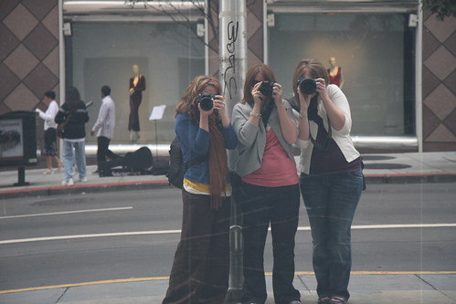 How to get all three of you in a photo with your camera, find something shiny.