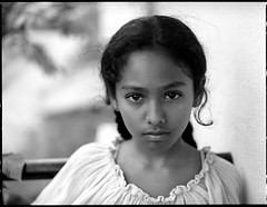 Portrait of a neighbour (Vivek M.) Tags: new portrait urban girl fuji neighbour 6x45 100asa acros 75mm bronicaetrs