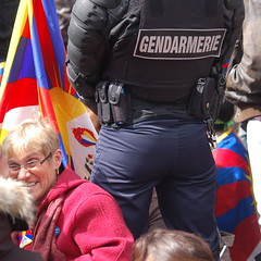 The Lady by the Cop's Butt (Rarohonda) Tags: paris ass hardware gun flag butt police tibet armor cop law officer whistle gendarme policeofficer gendarmerie tibetanflag ptotests