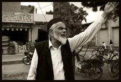 showing the way... (Amar Jain) Tags: bw car oldman directions jaipur pinkcity acceleration bluelist