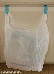 Plastic bag on over-cabinet hooks