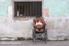 Portable House (Mysterious Moon) Tags: poverty charity portrait people wheelchair cuba disabled disability exoticwindow