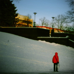 the little red man (saicode) Tags: blue red snow man buildings funny outoffocus unusual vignette tone pola muted redjacket cartoonlike