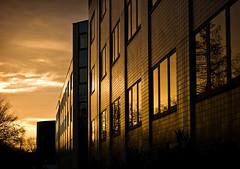 Reflets du coucher de soleil (Osbern) Tags: sunset orange jaune buildings noir hiver normandie soir normandy immeuble verre eure bton evreux xxe contemporaine paysageurbain