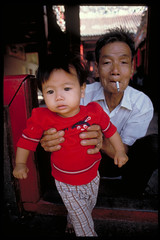 Proud Grand Father (briyen) Tags: old red baby man cute love girl proud child grandfather smoking vietnam