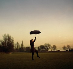 Day 165 - Something always brings me back to you. (miriness) Tags: trees portrait sky girl field grass umbrella pose wind dramatic windy marypoppins baretrees featuredonadidapcom miriness