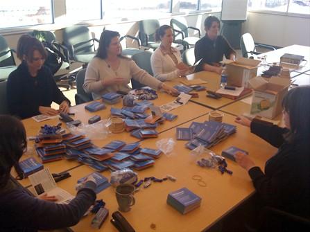 Volunteers assembling kits