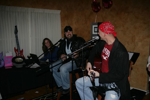 Dave and Paul singing, while Haley plays DJ