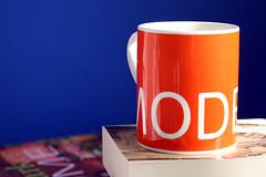 28/30: Modern Cup (JustaPlaneRideAway) Tags: blue orange cup coffee books tatemodern mug bedside