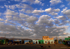 Clouds above Asaita village, Danakil, Ethiopia (Eric Lafforgue) Tags: africa city sunset sky people cloud shop horizontal retail clouds outdoors photography day colours village market couleurs goat wideangle nomad ethiopia tribo afrique nomade nomadic eastafrica thiopien etiopia ethiopie etiopa colorimage smallgroupofpeople ruralscene buildingexterior unrecognisableperson lafforgue  danakil etiopija ethiopi  ericlafforgue etiopien nomadiclife etipia  etiyopya    danakildepression assaita asaita  700626 vienomade abissnia      afardepression a700626