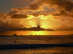 Another fabulous sunset at Waikiki, Oahu, Hawaii. (RuthannOC) Tags: ocean cruise sunset sky people cloud sun beach clouds swimming silver boats island hawaii islands sailing ship glow pacific waikiki oahu hawaiian surfers yachts setting aloha oconnor lining ruthann photooftheday gadling 5photosaday seasunclouds