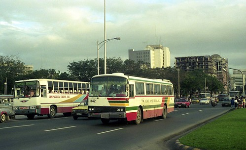 Sampaguita Transit Hino NYB-853 & New E Jose Trans Hino RV (342) in Roxas Boulevarde at Luneta Park, Manila, Philippines. by express000.