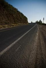 Road along the hills (jsbfin) Tags: california road blue sunset sky tarmac hill curve asphalt gravel