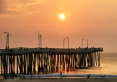 Virginia Beach Sunrise (` Toshio ') Tags: ocean sea people woman sun man beach water clouds sunrise person virginia pier wooden fisherman sand colorful fishermen atlantic va 500mm virginiabeach hamptonroads toshio tidewater