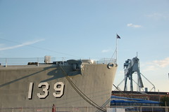 "USS Salem: Ships bow flag & nearby General Dynamics shipyard crane ""Goliath"" (Chris Devers) Tags: ocean city bridge sea building water car shop skyline museum architecture river ma quincy boat store ship lift unitedstates arm crane flag massachusetts navy machine vessel company maritime vehicle drawbridge salem nautical goliath naval 2008 usnavy weymouth cruiser uss warship coldwar liftbridge shipbuilding quincyma foreriver usssalem heavycruiser foreriverbridge ca139 cameranikond50 forerivershipyard weymouthma exif:iso_speed=200 exif:exposure=0002sec1500 exif:focal_length=34mm unitedstatesnavalshipbuildingmuseum exif:exposure_bias=06ev exif:aperture=f42 camera:make=nikoncorporation camera:model=nikond50 meta:exif=1257954860 exif:orientation=horizontalnormal exif:filename=dscjpg meta:exif=1350405580"