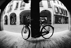 parking available (birdcage) Tags: blackandwhite bw italy bicycle wideangle fisheye pentaxk1000 padua