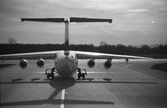 Lineup and Wait (Lost in Transition) Tags: shadow airplane lh grainy muc takeoff runway lufthansa ilford avro lineup cityline b13 delta400 eddm 26l lostintransition eos7s matthiasfranke marrymeflyforfree