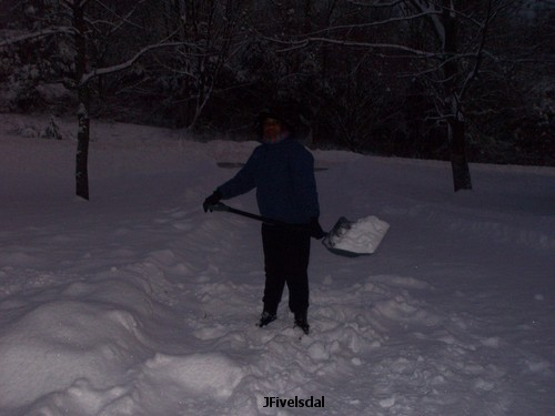 Jennifer shoveling snow