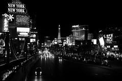 Cities within a City (wenzday01) Tags: road city travel vegas bw night lights nikon cityscape nightscape traffic lasvegas nevada monotone nv adobe thestrip nikkor lightroom d90 ilfordxp2super400 mikeyg nikond90 twtmebw presetsheaven 18105mmf3556gedafsvrdx