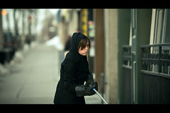 Window cleaning duty (Dom Cruz) Tags: street winter portrait people woman ontario canada girl canon downtown dof bokeh candid guelph streetphotography cleaning hoody rubbergloves cinematic squeegee lateafternoon windowcleaning f20 135l canonef135mmf2lusm 40d canoneos40d