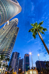 Downtown KL (Jim Boud) Tags: longexposure travel bridge tower skyline night buildings mall lens asia downtown cityscape skyscrapers nightshot dusk wideangle skybridge palmtrees malaysia future spacestation twintowers rocket spaceship bluehour kualalumpur usm efs 1022mm hdr highdynamicrange klcc futuristic suria petronastowers artisticphotography superwideangle multipleexposures petronastwintowers asiapacific canonefs1022mmf3545 kualalumpurcitycenter jimboud canoneos60d jamesboud