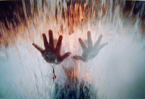 hands through the waterfall