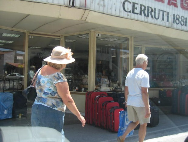 street travel summer sun hat photography couple cyprus luggage pedestrians shorts suitcases limassol sunhat cerruti 1881 lemesos