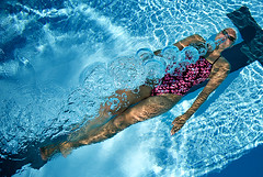 Human torpedo (Martin Gustafsson) Tags: blue water pool girl under bubbles malmoe swimmer malm winnerbc