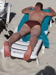his feet are already burned.. (marky.t) Tags: boy sleeping sun guy beach relax back sand legs tan blond barefeet speedo
