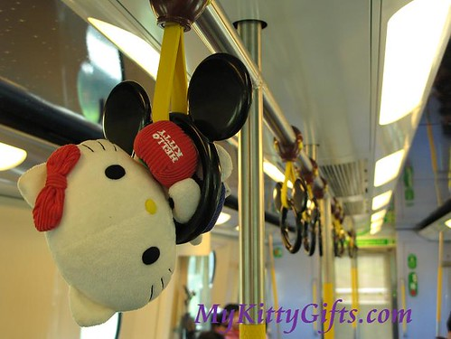 Hello Kitty Swinging on Disneyland Train Hand Grab