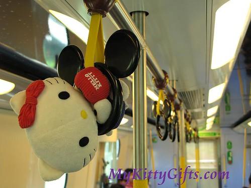 Hello Kitty Swinging on Disneyland Train Hand Grab