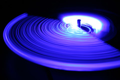 LED Drink Stirrer (Audiotribe) Tags: longexposure blue light abstract color colors digital canon lampe licht exposure glow colours snake lumire spin trails experiment led trail trippy lys eyecandy bikelight cahaya svjetlo ligero ljus ledlight slange sooc eos400d flickraward  ledlicht exposureeffect lysspor