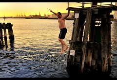 flight of the lunatic (mugley) Tags: sunset water digital swimming docks paul insane jump nikon shed dive australia melbourne victoria cranes brave docklands ripples dslr manky stoopid iso1600 victoriaharbour polluted wideopen d300 armsout northwharf channelmarkers melbourneatnightmeet tokina1224mmf4atxpro tokinaaf1224mmf4 vermininc minorcrop