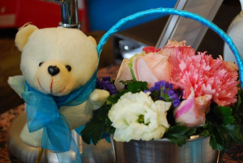 Teddy and flowers.