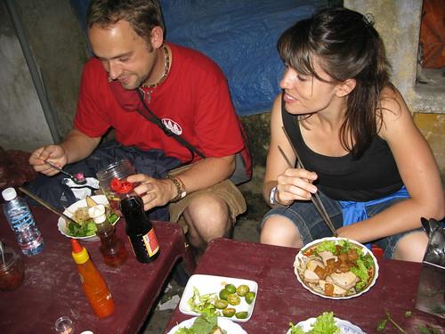 Friends eat street food cau lau, Hoi An, Vietnam