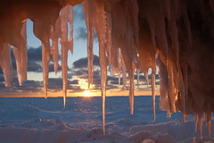 Ice Cave (Kristina_5) Tags: statepark winter sunset snow ice clouds golden michigan sandy lakemichigan greatlakes grandhaven icecave icecicles grandhavenstatepark flickrenvy amemoryofourdailylife dragonflyawards mindigtopponalwaysontop
