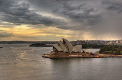 Sydney Opera House at Sunset from the Bridge (HDR) (Craig Jewell Photography) Tags: city bridge sunset orange house storm architecture night clouds lights evening opera cloudy harbour sydney overcast australia multipleexposure operahouse hdr multiexposure aficionados 5photosaday pentaxk10d bestofaustralia flickrgolfclub justpentax craigjewellphotography