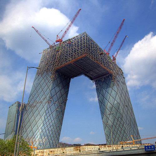 "Cranes In The Sky. Is this not the most insane building in the world?  <a href=""http://digg.com/travel_places/Beijing_Most_insane_building_in_the_world_5"" rel=""nofollow"">digg</a> this pic. Or have you <a href=""http://reddit.com/info/6gt5t/comments/"" rel=""nofollow"">reddit</a>?  About the building: The project was started in september 2004 following a review of the design by a panel of Chinese experts. The construction is scheduled to be completed in time to broadcast the Beijing Olympics in 2008. The development is being undertaken by the Chinese Government as part of a plan to redevelop central Beijing with innovative and functional architecture, while preserving historic buildings at the same time. The new building will involve two L shaped high-rise towers linked at the top and the bottom at an angle to form a loop, which has been described as a Z criss-cross. The total construction cost is estimated at €600 million ($750 million). The CCTV tower will employ 10,000 people following completion in 2008. But the construction was daleyted because of the opposition against this buildings cost, so the developers say the building will probably not be completed before 2009. (Source: SkyscraperCity) It was designed by Rem Koolhaas and his company OMA.  About the image: This high definition range image was created with three RAW files. Ive created four different HDR versions and edited the best out of each version on top of the other. Took me over two hours to finish this beast in Photoshop.  Taken in Beijing, China.  - Jakob  Im always posting pictures and videos on my blog in high res, be sure to <a href=""http://jakob.montrasio.net/"" rel=""nofollow"">check it out</a>!  Explored: 2008-04-23   #487"