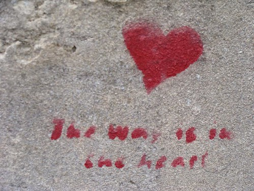 graffiti: red heart and the words (faint): the way is in the heart