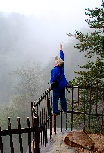 Peace (Poopshe_Bear) Tags: boy cliff mist mountain mountains tree sign rock tallulah georgia landscape stand rocks peace rail photograph brave gorge railing peacesign precipice courage daring adventurous couragous poopshe poopshebear