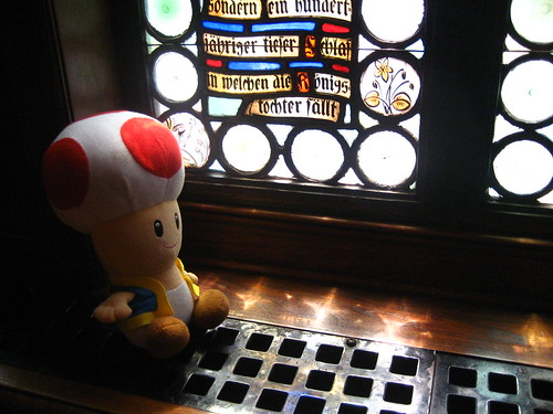Toad reads some fairy tales etched in the stained glass