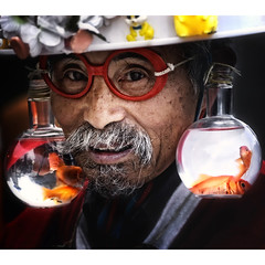 oldman and his golden fish (ajpscs) Tags: street old red summer portrait fish man face hat japan japanese gold tokyo interestingness interesting nikon goldfish earring oldman moustache explore harajuku  nippon  d100 eyeglasses   goldenfish ajpscs