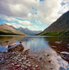 elizabeth lake (thespeak) Tags: mountain lake mountains montana rocks hiking pinhole glacier bearmountain backpacking relection backcountry hiker glaciernationalpark campground zero2000 zeroimage gnp manyglacier wideanglezero elizabethlakefoot