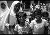 school girls in front, boys in back (LindsayStark) Tags: travel school portrait blackandwhite girl kids children war child muslim islam religion hijab conflict srilanka schoolkids humanrights humanitarian trincomalee trinco southasia displaced idpcamp idps idp humanitarianaid emergencyrelief postconflict waraffected conflictaffected peopleofsrilanka