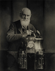 Sir William Thomson, Baron Kelvin, 1824 - 1907. Scientist, resting on a binnacle and holding a marine azimuth mirror (National Galleries of Scotland Commons) Tags: portrait beard 1900 instruments brass scientist tweed steampunk lordkelvin binnacle nationalgalleriesofscotland greatscots baronkelvin sirwilliamthomson azimuthmirror trannansons