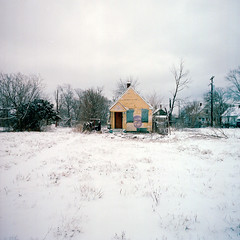 Abandoned house in Detroit, Michigan (Kevin Bauman) Tags: door city urban building abandoned industry film wall facade buildings downtown industrial doors exterior decay michigan detroit hasselblad abandonedhouse abandonment decaying crumbling abandonedhouses